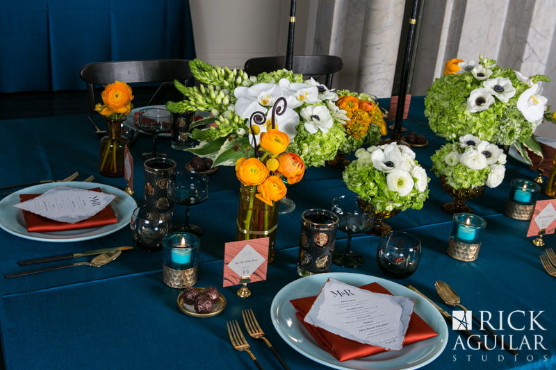 wedding table with teal, white and orange flowers