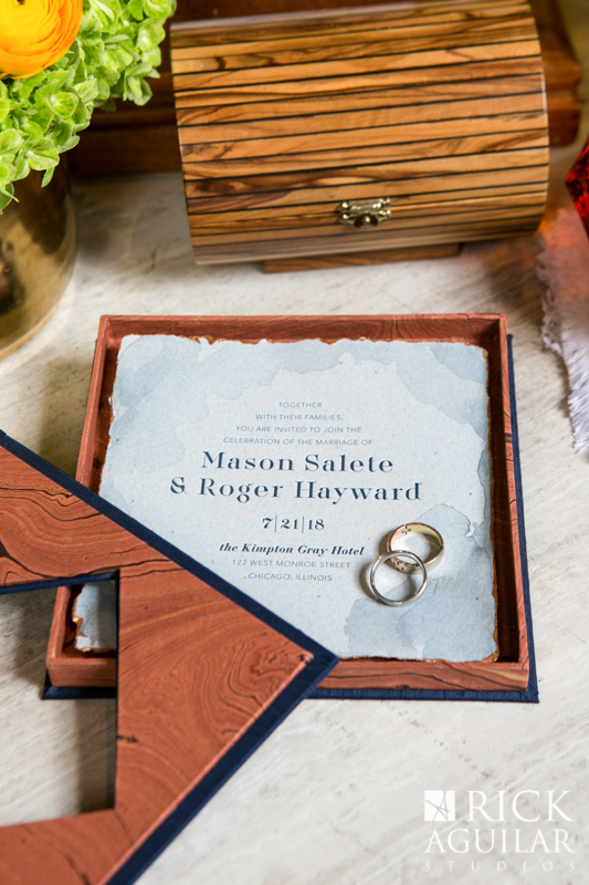 wooden wedding invitation with wedding rings